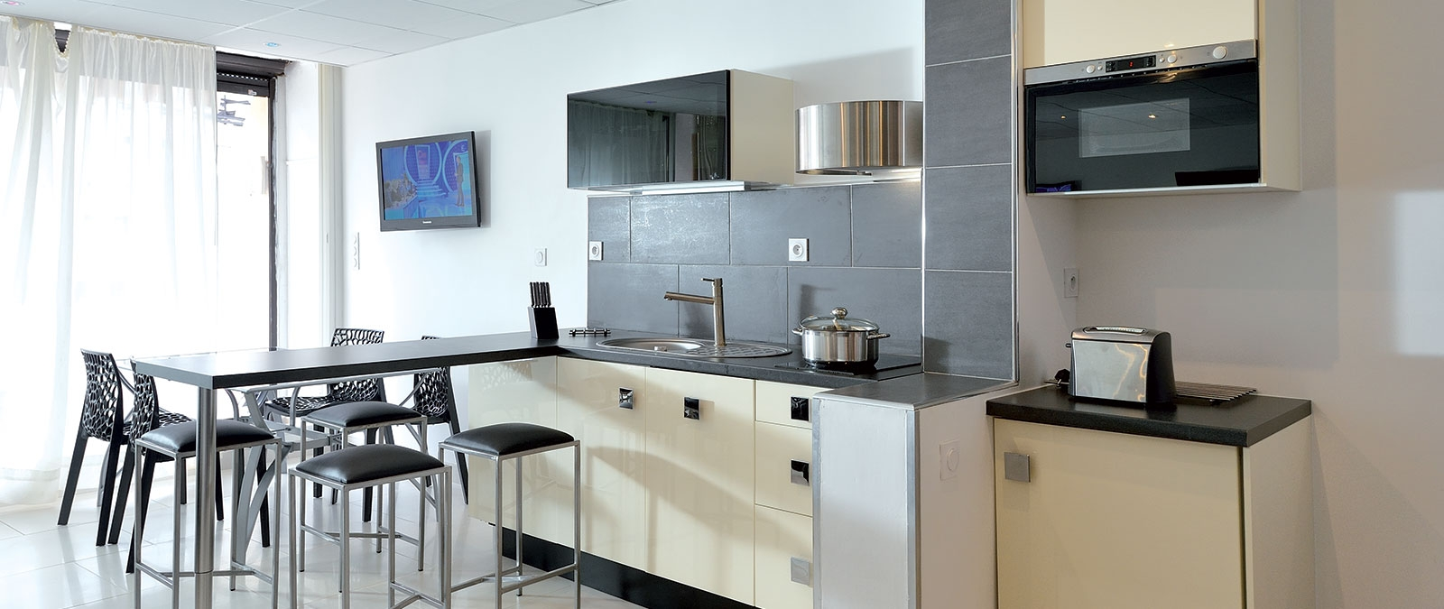 Kitchen area Chrome naturist studio flat for rent